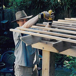 Author work on a cedar pergola